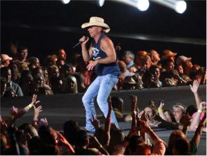 Chesney lets his fans know he doesn't so much sing about reality but rather about escape from reality.