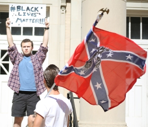 The students on campus generally want to take the state flag down, but the outside community staged counter-protests. Thank you DAILY MISSISSIPPIAN for the image.